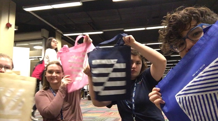 Showing off our tote bags from Herff Jones!