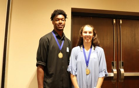 Eric Galbreath (left) and Evann Seratte (right) stand for a picture at the Community Education Breakfast on September 7. The two seniors won the Student Champion Award.