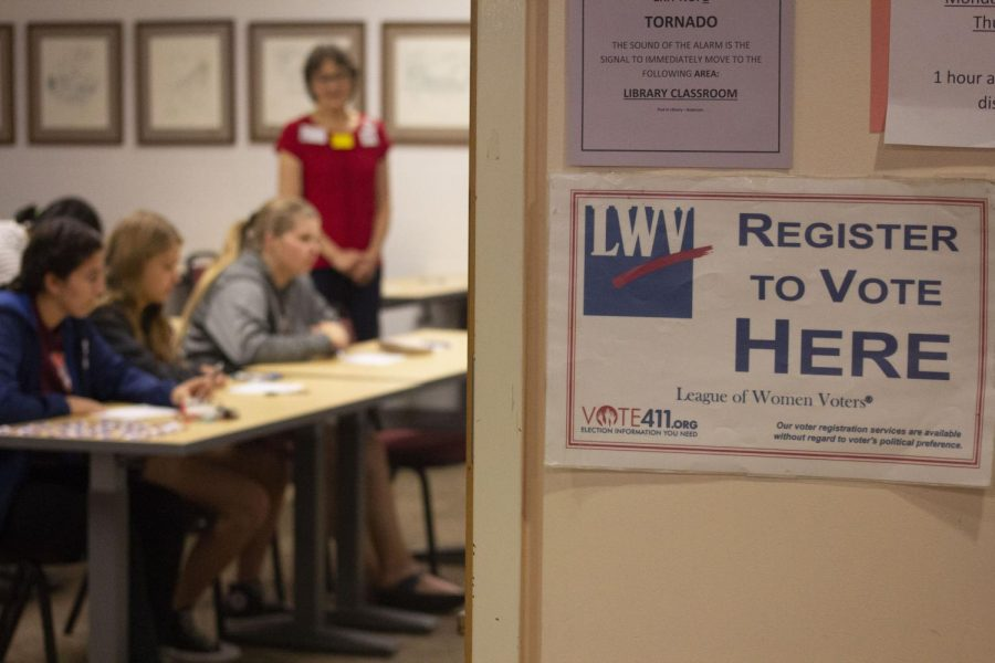 Students register to vote with the League of Women Voters on September 21.