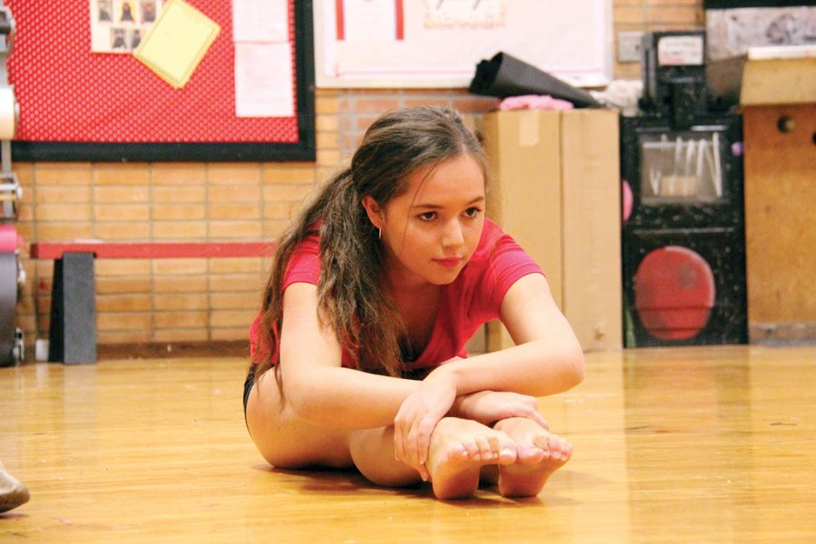 "Senior Zuzu Melchor prepares for practice on Nov. 8 after joining the team following October tryouts. While this is Melchor's first year on the pom team, she has several previous years of dance experience. ""It's super fun being on the team, not only because of the dancing, but also the people,"" Melchor said. ""I mostly do contemporary dance, so pom is very different than what I'm used to, but that's what's so fun about it."""