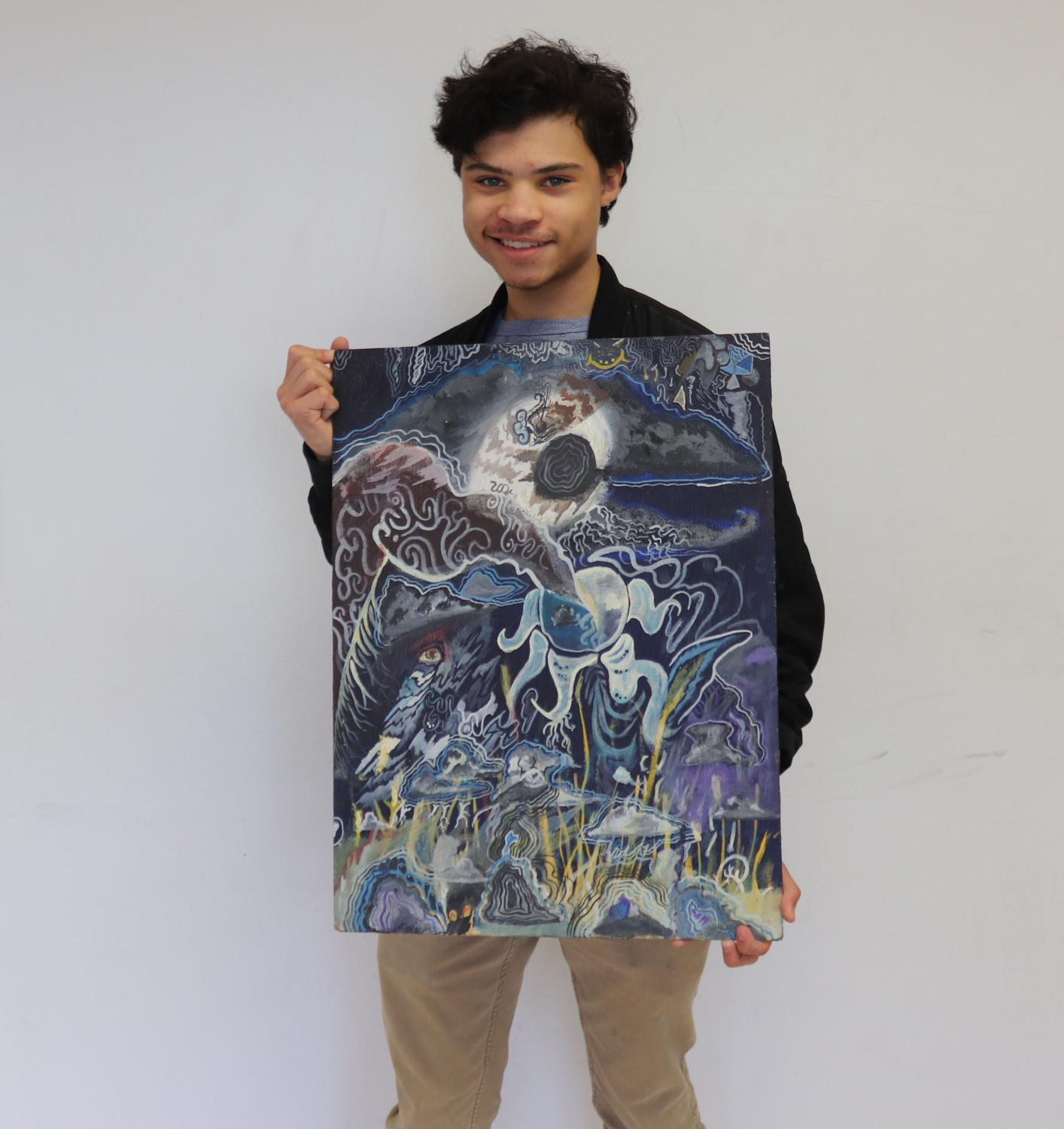 Senior Gabriel Sears with his painting, the Wrath of Jupiter