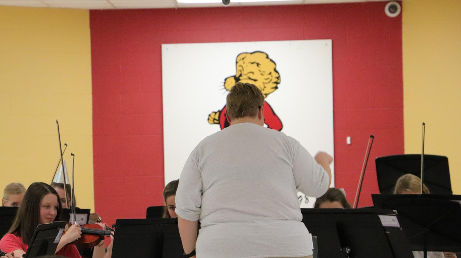 Orchestra teacher Mariah Barnett conducts for the orchestra at their Oktoberfest on October 7.