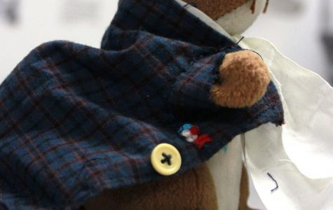 Students and staff make costumes for stuffed squirrel used in history class