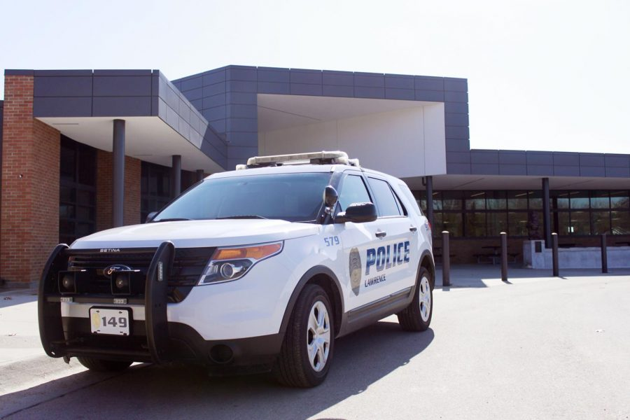 A Lawrence Police Department SUV is parked outside Lawrence High School on the afternoon of Tuesday, Feb. 12. Earlier in the day, a gun was removed from a student at school. It was the second such incident in less than a week.