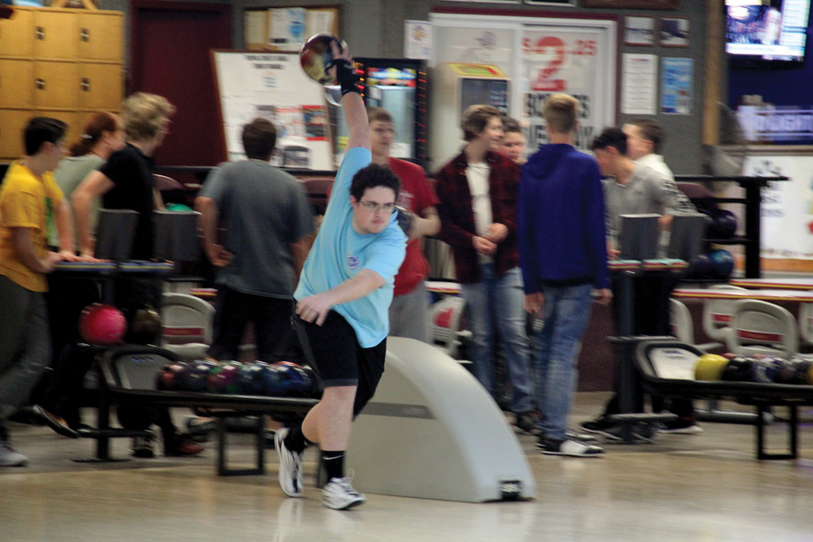 Junior Andrew Flynn prepares to throw the ball during a practice after school.