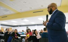 Superintendent Anthony Lewis meets speaks during a community meeting at Lawrence High School on Thursday night to address school safety issues.