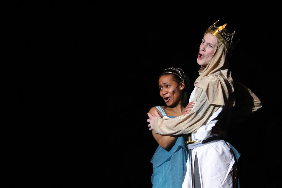 "Senior TIffani Smith holds onto junior Jack Malin in the winter production of Spamalot. Smith played the character Lady of the Lake while Malin played King Arthur. ""It was a lot of hard work and a big time commitment. You really had to balance your time out and priorities always came first,"" Smith said. ""I really enjoyed getting to know the cast. Most people I didn't really have classes or activities with, so I made lots of new friends."""