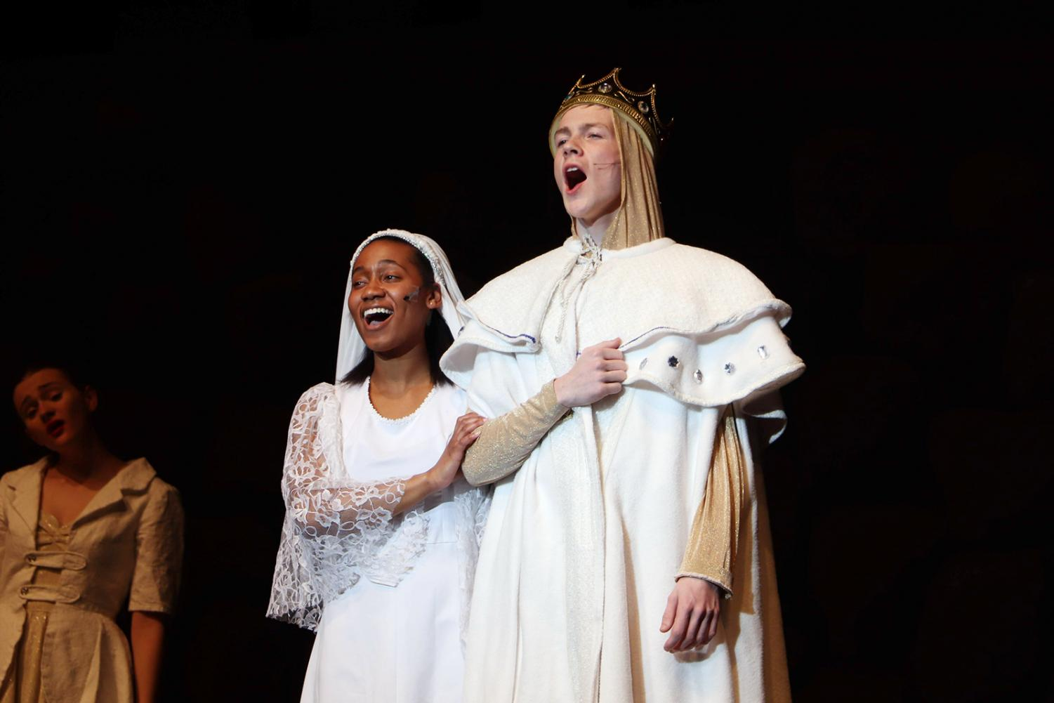 In+harmony%2C+senior+Tiffany+Smith+and+junior+Jack+Malin+stand+side+by+side+during+the+finale+of+the+winter+musical%2C+Spamalot+on+Jan.+25.+The+wedding+scene+closed+out+the+show+for+the+last+time+and+wrapped+up+the+story+of+King+Arthur+and+his+search+for+the+Holy+Grail.+