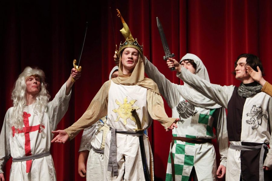 Being praised by his trustworthy adversaries, junior Jack Malin urges his men to travel to Camelot during the winter musical, Spamalot on Jan. 25. The cast missed several days of rehearsals due to snow and below freezing temperatures but still managed to put on a royal performance.
