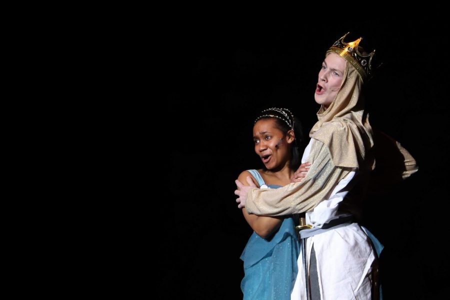 Playing the part, senior TIffani Smith holds onto junior Jack Malin in the winter production of Spamalot. Smith played the character Lady of the Lake while Malin played King Arthur.
