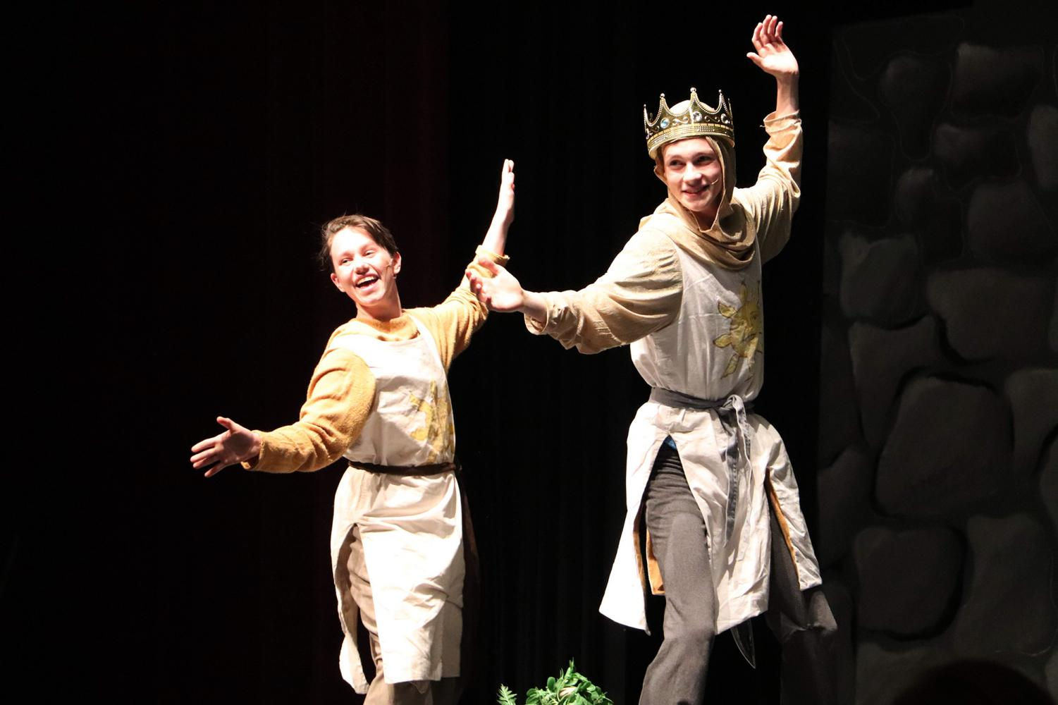 Grinning%2C+senior+Julian+Weslander+and+junior+Jack+Malin+dance+during+the+song+%22Always+Look+on+the+Bright+Side+of+Life%2C%22+during+the+winter+musical%2C+Spamalot+on+Jan.+25.+Malin+played+King+Arthur+and+Weslander+played+Arthur%27s+trusty+servant.+The+two+travelled+far+and+wide+in+search+of+the+Holy+Grail+for+two+almost+sold-out+nights%2C+making+Spamalot+the+highest+attended+musical+in+five+years.