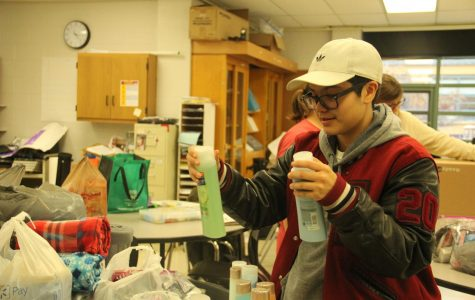 Junior Josh Sanchez helps pack donations for the Navajo Nation of Arizona and the Pine Ridge Indian Reservation of South Dakota reservations during an Inter-tribal Club meeting.