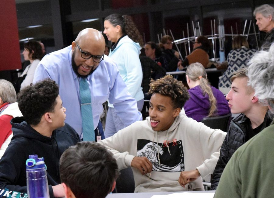 Interacting with students, Superintendent Anthony Lewis gets input from those who attended the Community Safety Meeting addressing weapons brought on Lawrence High campus on Feb. 21. Lewis' goal of the meeting was to reassure parents that the safety of staff and students was the most important.