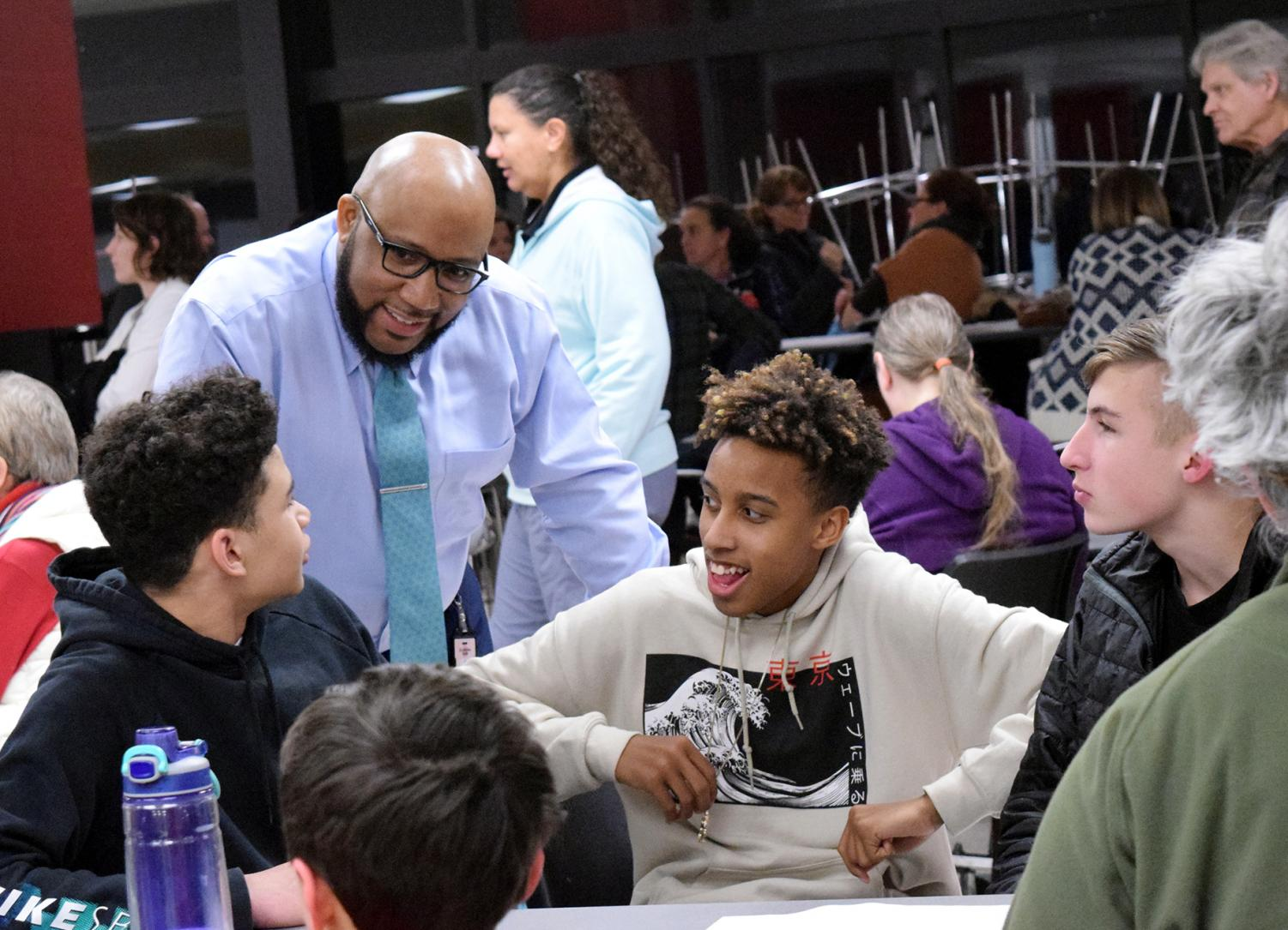 Interacting+with+students%2C+Superintendent+Anthony+Lewis+gets+input+from+those+who+attended+the+Community+Safety+Meeting+addressing+weapons+brought+on+Lawrence+High+campus+on+Feb.+21.+Lewis%27+goal+of+the+meeting+was+to+reassure+parents+that+the+safety+of+staff+and+students+was+the+most+important.