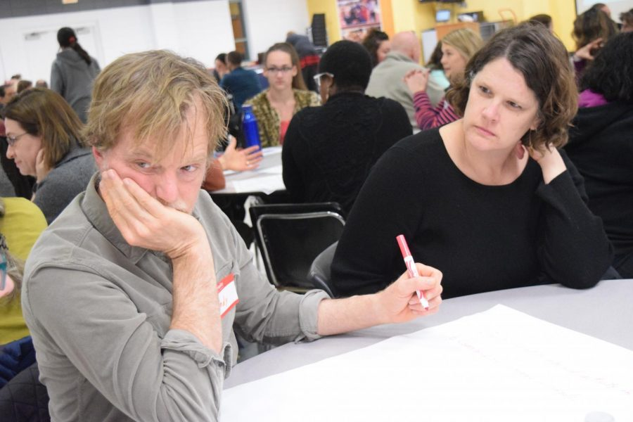 Science teacher Andy Bricker sits with other participants at the Community Conversation on Feb. 21 in the Lawrence High cafeteria. The district gathered input at the meeting about how to improve school safety.