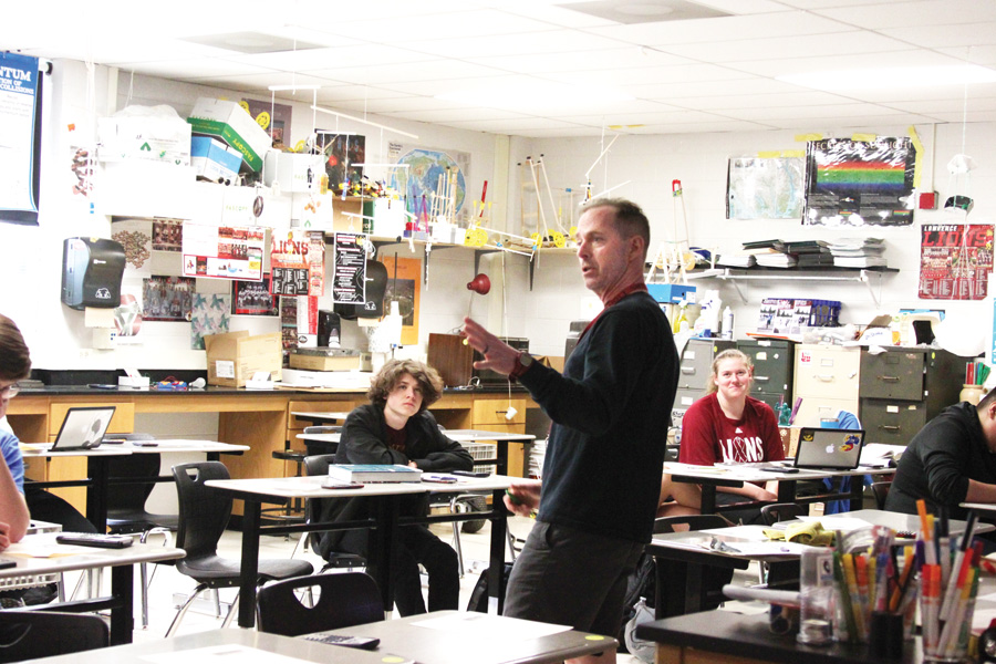 Physics teacher Alan Gleue teaches his sixth hour class on April 16. Several classes have fallen behind on work due to the number of snow days and are struggling to catch up before the end of the school year.
