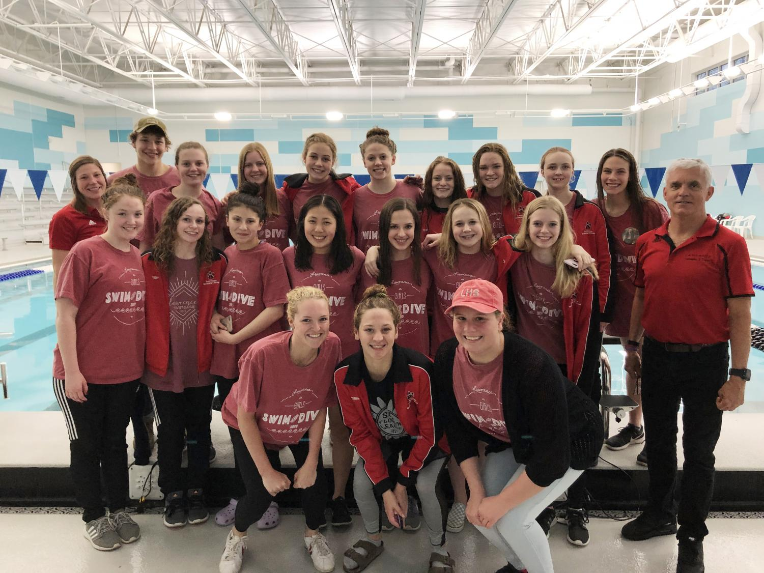The girls swim team won league on May 4 for the first time since 1994.
