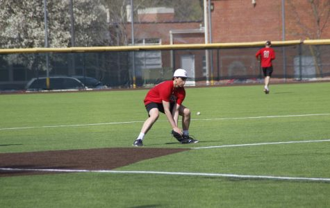 Senor pitcher Jackson Hewins fields a ground ball in practice. Hewins, after tearing his UCL, recovered from surgery in time to star in his senior season.