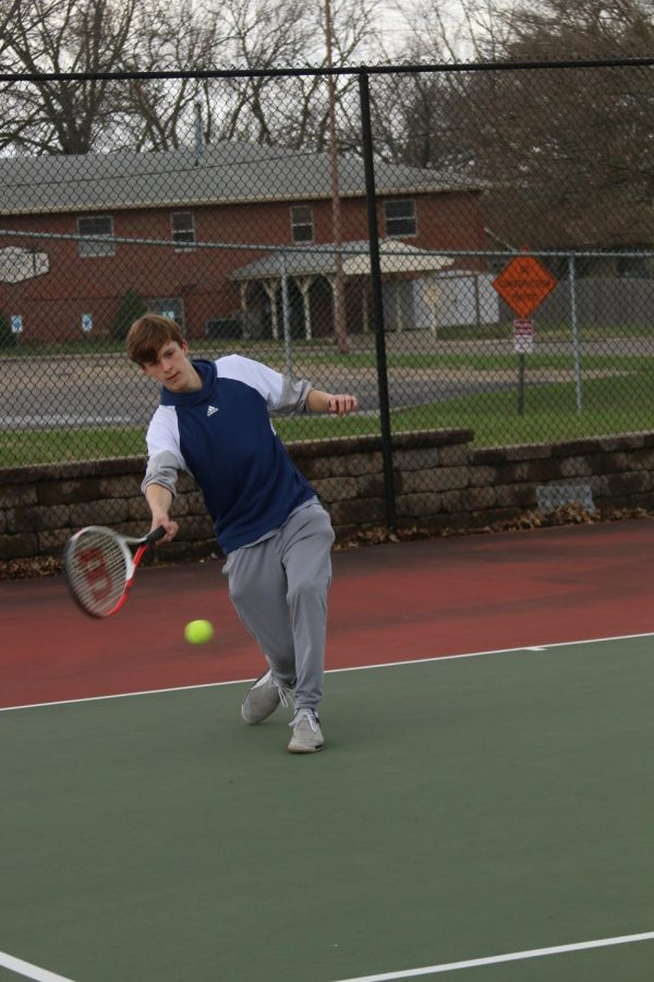"Freshman Ryan Hardie returns the ball during tennis practice on April 4. ""You have to practice and learn you will make mistakes and you got to learn from your mistake,"" Hardie said. ""Getting down the mental toughness that you need to play tennis, like if you make a mistake you got to power through it. That's the one thing you can't practice and have to focus on that."""