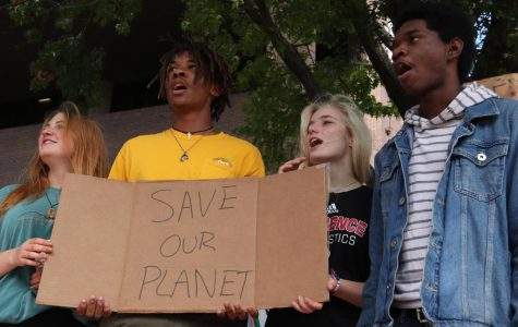 Speaking out, juniors, Isaac Ngoh, Reece Wohlford and Donnavan Dillon take part in the international climate strike on Sept. 20.