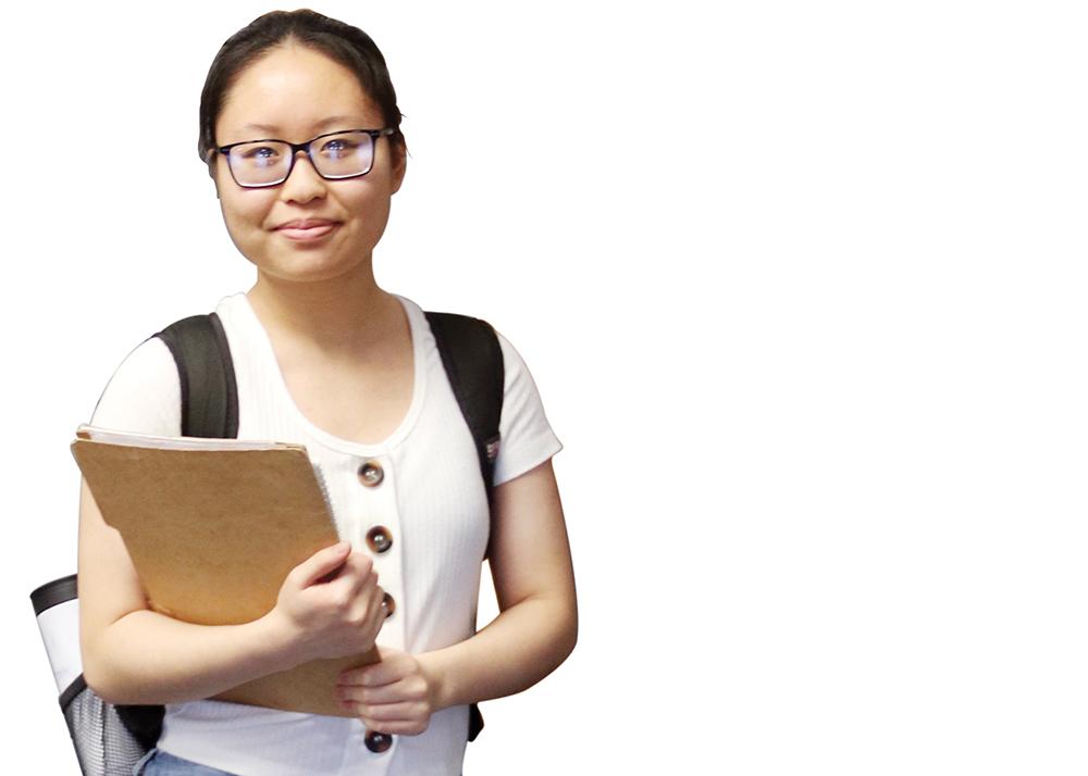 National Merit Scholar Semifinalist Lisa Yang poses with her school supplies.