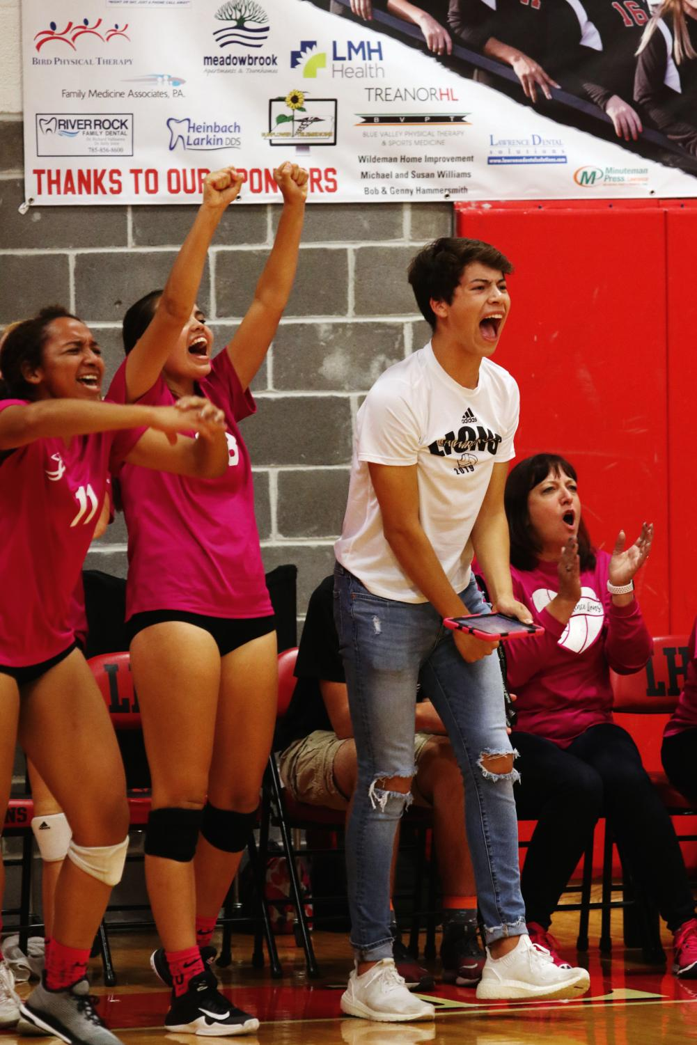 "Cheering on the team, sophomore Nick Cordova helps the team from the sidelines. Head coach Stephanie Scarbrough speaks highly of Cordova's contributions to the team. ""We have a lot of confidence in his knowledge of the game and his ability to communicate that to the girls in a positive and constructive manner.  He is a vital member of our team."""
