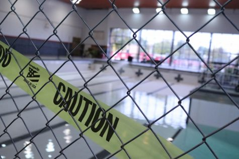 """Caution"" tape covers the entrance of Carl Knox pool as it remains closed for storage."