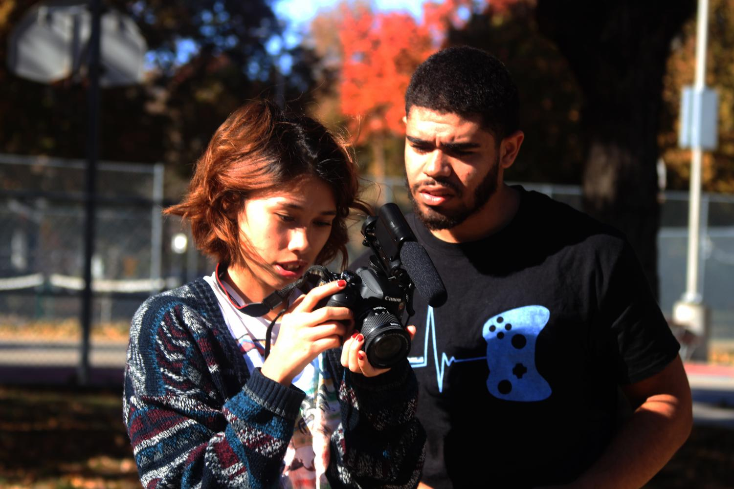 Film students Mia Robinson (left) and Kindred Curry (right) review a shot.