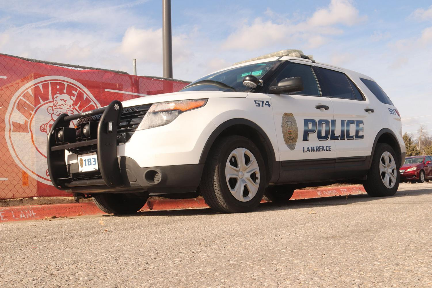 A police car is parked by Lawrence High School on Thursday afternoon, a day after a firearm was confiscated from a student.