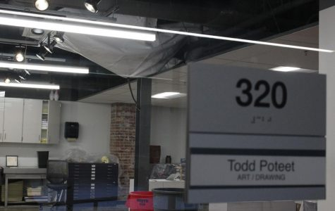 A tarp is draped across the ceiling of art teacher Todd Poteet's classroom to prevent further leaking.