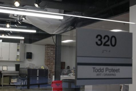 A tarp is draped across the ceiling of art teacher Todd Poteet
