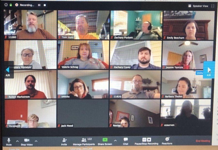 Faculty convene over video app Zoom for their first professional development session.