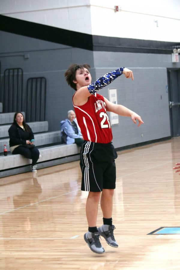 Reacting to his 'sinking three', senior Alan Jackson 'AJ' Sanders proves to be a key player on this year's Unified Sports basketball team. Sanders, who has been involved in Unified Sports all four years of high school, is the definition of an all-around athlete who simply can't get enough of the game.