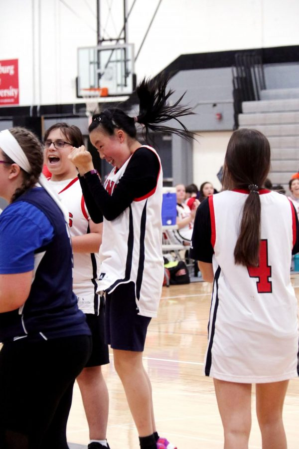 Jumping for joy, junior Joy Song scores in her Unified Basketball game. Song always has a blast competing with her team and she prides herself on her championship mentality.