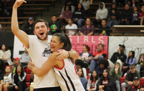 Showing the love, senior Ryan Lauts gives his mom (Mrs. Lauts) a hug. Lauts yelled to the crowd