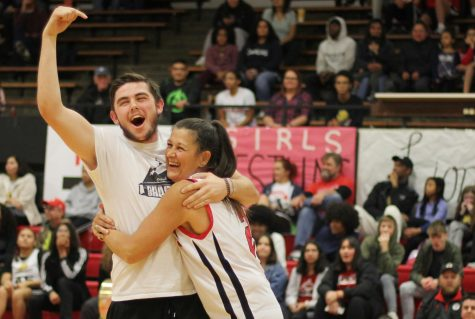 """Showing the love, senior Ryan Lauts gives his mom (Mrs. Lauts) a hug. Lauts yelled to the crowd """"that"""