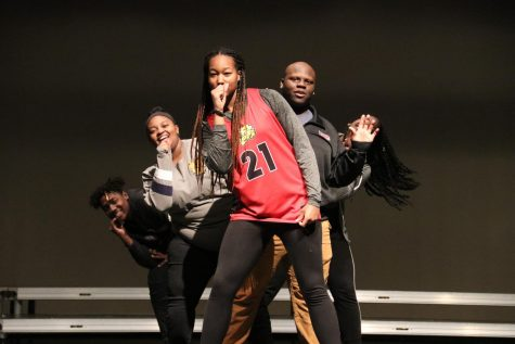 CAPTION: After hours, student performers Vincent Otchere, Trinity Shorter, Kayla Glabreath, Jelani Ragins, and Tracy Allen seek refuge in the auditorium. Because administrators have a strict