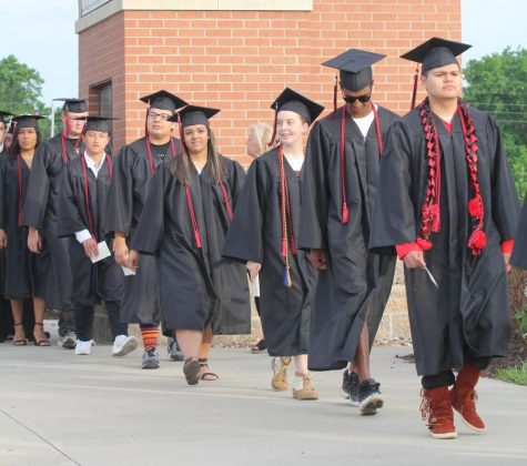 Walking into the stadium, members of the class of 2018 attend their graduation. Two years later, members of the class of 2020 may finally get to take that same walk — or something similar — during a graduation ceremony planned for July. Graduation was delayed due to COVID-19.