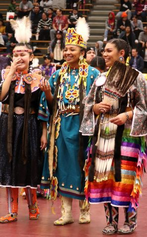 Native American students participate in powwow