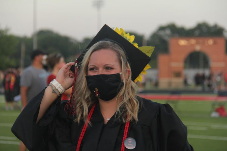 After a nearly two-month delay, Lawrence High seniors graduated on Saturday night. Participants were told to wear masks and stay distant as COVID-19 cases have been rising rapidly in Douglas County and the state overall. The stands remained clear. Instead graduates and their guests walked through the event at tiered times.