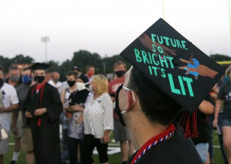 Photos: Graduates take part in modified ceremony