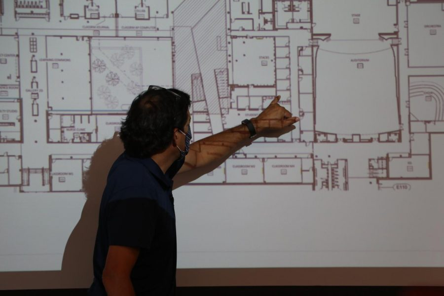 Pointing, USD 497 Executive Director of Facilities & Operations Tony Barron explains the layout of the new building.