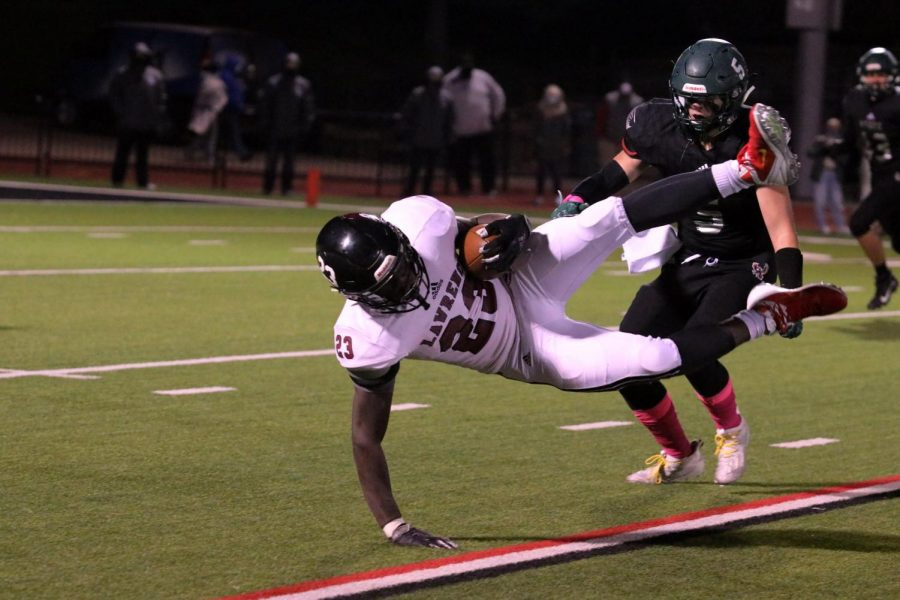 In the air, senior Ntense Obono prepares to hit the turf after an incomplete tackle by Free State.