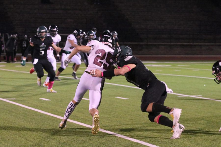 New to the field, sophomore Sam Sedo avoids being tackled and carries the ball twenty yards.