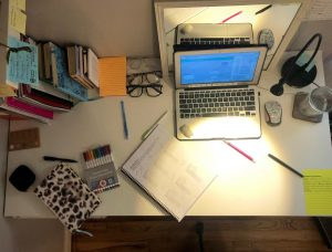 A desk is left scattered with supplies needed to study in online school. Students will have the chance to return to campus for learning on October 19th.