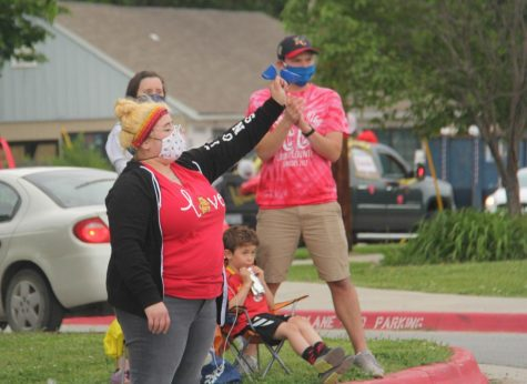 English teacher Abby Hoffman waves to students from a distance during the Celebrate the Date in late May 2020.