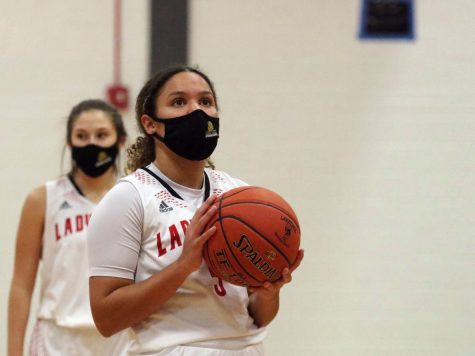 Preparing for a free throw, sophomore Amaya Marshall focuses on the basket during a home game on Jan. 12.