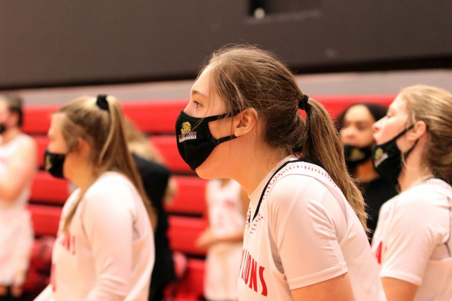 Getting pumped, sophomore Morganna Haaga cheers on her teammates from the sideline.