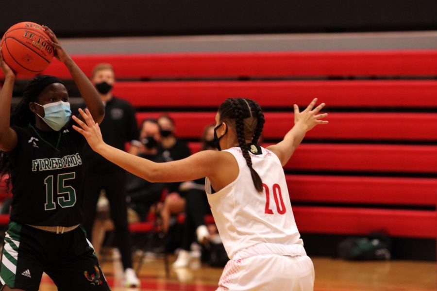 On the defense, sophomore Lucy Hardy protects against Free State number 15.