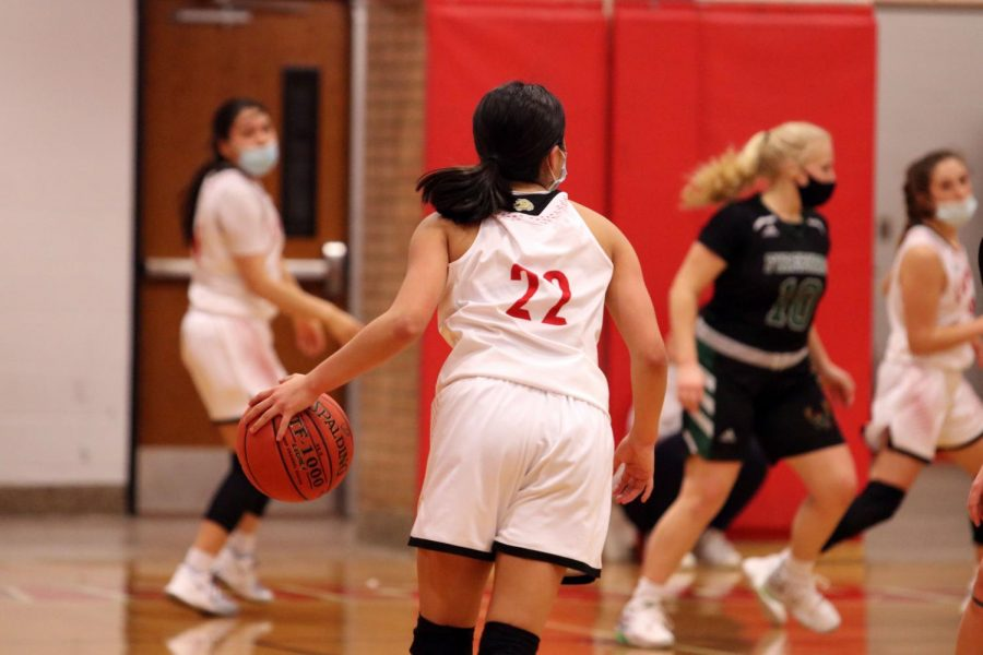 Sophomore Serenity Keo brings the ball down the court to score against Free State.